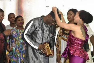 [Photos]Tonto Dikeh decorates Dino Melaye as 'Outstanding lawmaker of the year'