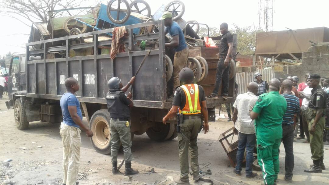 Photo of Lagos Arrests 30 Cart Pushers For Dumping Refuse On Road Medians