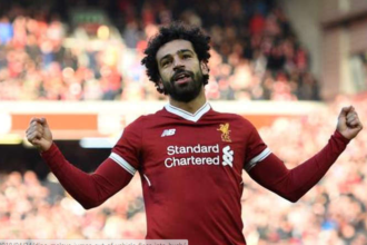 Salah, Van Dijk score as Liverpool beat Wolves to stay four points clear