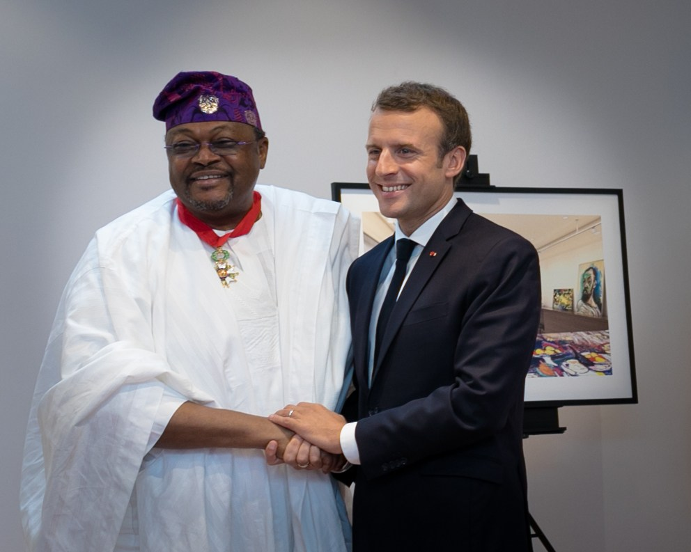 "Photo of Macron confers ""Commander of the Legion of Honour"" on Globacom boss, Adenuga"