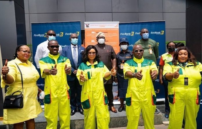 First Bank Partners LAWMA, Unveils 16,000 Sweepers' Uniforms
